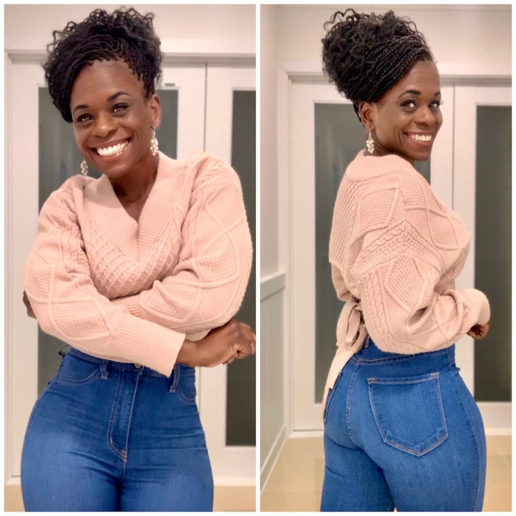 Octavia Scott in a Pink Sweater and High Waisted Jeans
